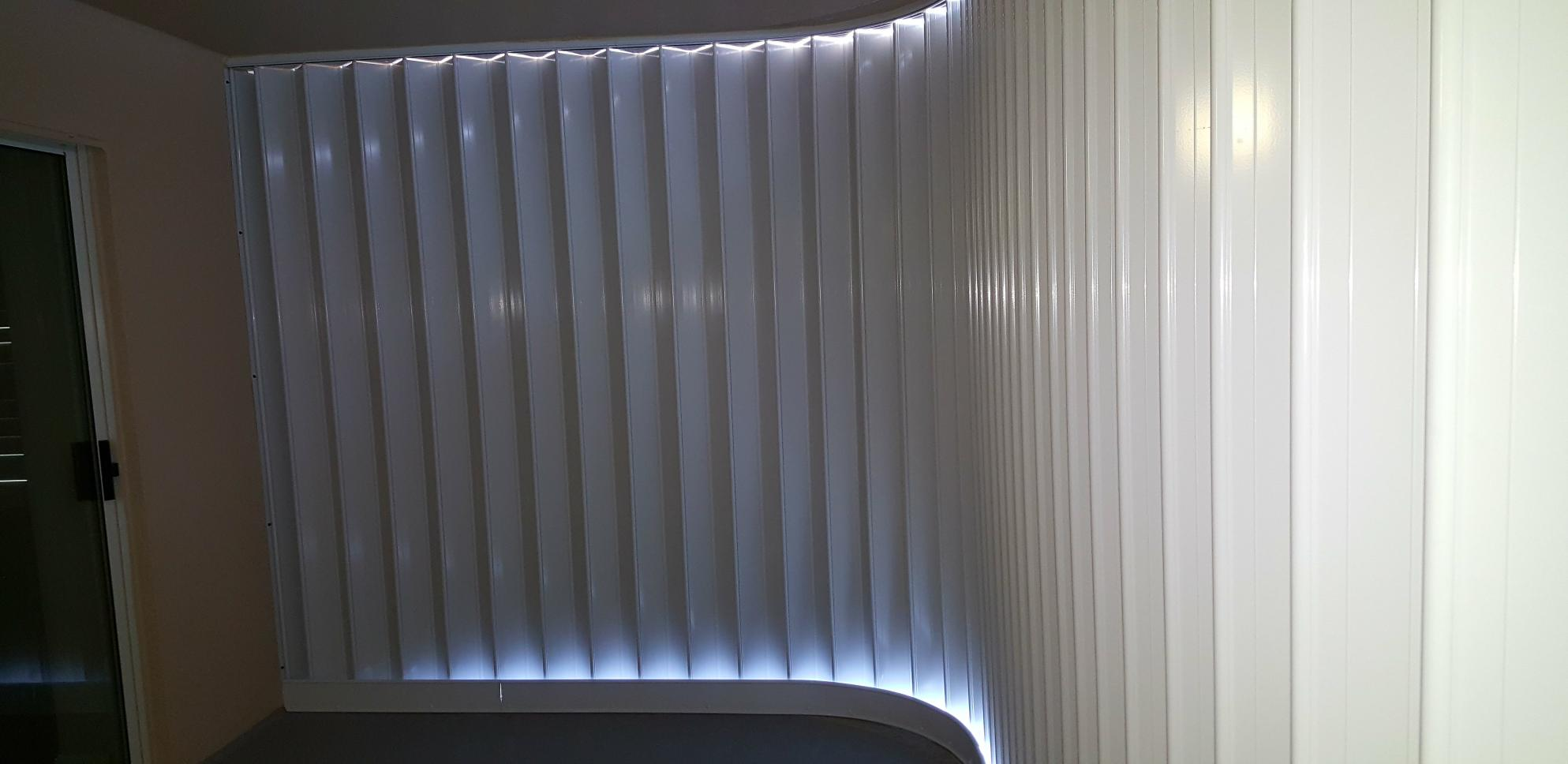Accordion Shutters Enclose A Large Balcony Or Opening With